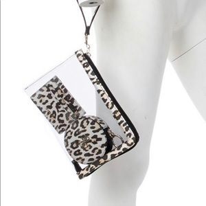 Guess 3 in 1 wristlet set. NWT comes in gift box.